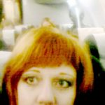Woman 'photobombed by alien' during selfie on passenger jet on business trip