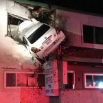 Speeding car takes flight, plows into 2nd floor of building