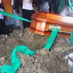 Son falls in grave during fathers burial